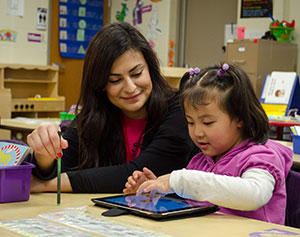 Student Cristal Aldrete works with a student at Northview Elementary