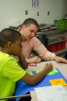 Student Dallas Jones teaches math at Fort Riley Middle School