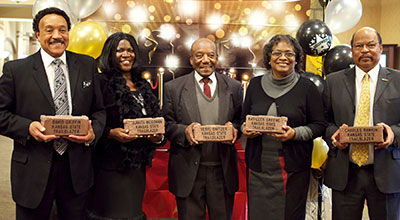 Dr. David Griffin, Dr. Juanita McGowan, Veryl Switzer, Dr. Kathy Greene, and Dr. Charles Rankin receive Trailblazer bricks for their service to K-State