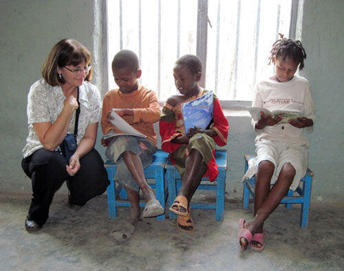 Dr. Laurie Curtis with children in Ethiopia photo
