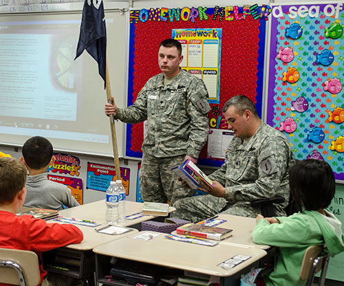 Soldiers read books to students at Bergman Elementary